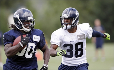 Running Back Demitrius Bronson (Left) and Cornerback Michael Dobson (Right) Photo Credit: komonews.com